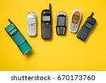 old mobile phones on yellow... | Shutterstock . vector #670173760