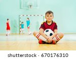 happy boy sitting on the floor... | Shutterstock . vector #670176310