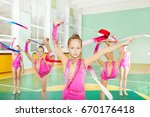 girls doing rhythmic gymnastics ... | Shutterstock . vector #670176418