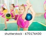 girl doing rhythmic gymnastics...   Shutterstock . vector #670176430