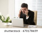 serious frustrated businessman... | Shutterstock . vector #670178659