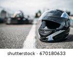 racer helmet on asphalt ... | Shutterstock . vector #670180633