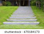 pathway in garden green lawns... | Shutterstock . vector #670184173