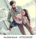 little daughter and her... | Shutterstock . vector #670218100