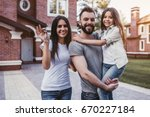 happy family is standing with... | Shutterstock . vector #670227184