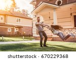 dad and daughter having fun... | Shutterstock . vector #670229368