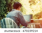 young man outdoor at terrace... | Shutterstock . vector #670239214