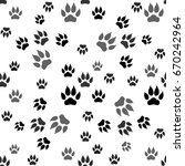 dog paw print seamless pattern... | Shutterstock .eps vector #670242964