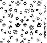 dog paw print seamless pattern... | Shutterstock .eps vector #670242964