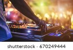 dj mixing outdoor at beach... | Shutterstock . vector #670249444