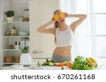 young woman making detox... | Shutterstock . vector #670261168