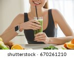 young woman making detox... | Shutterstock . vector #670261210