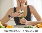 young woman making detox... | Shutterstock . vector #670261210