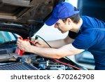 professional car mechanic... | Shutterstock . vector #670262908