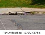 sidewalk and curb damage. | Shutterstock . vector #670273756