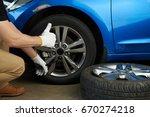 wheel change service. man... | Shutterstock . vector #670274218
