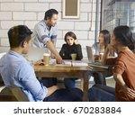 a team of multinational... | Shutterstock . vector #670283884