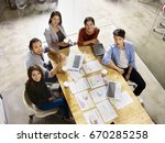high angle view of a team of... | Shutterstock . vector #670285258