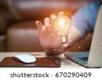 business women holding light... | Shutterstock . vector #670290409