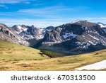 the alpine slopes of the rocky... | Shutterstock . vector #670313500