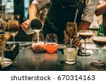 bartender making alcoholic... | Shutterstock . vector #670314163