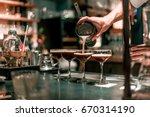 bartender making alcoholic... | Shutterstock . vector #670314190