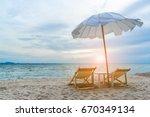 double beach chair on sand... | Shutterstock . vector #670349134