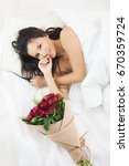 beautiful girl on the bed with...   Shutterstock . vector #670359724