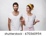 annoyed pretty woman gesturing... | Shutterstock . vector #670360954