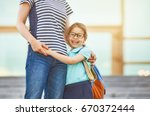 parent and pupil of primary... | Shutterstock . vector #670372444
