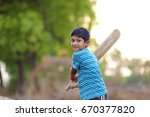 rural indian child playing... | Shutterstock . vector #670377820