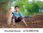 rural indian child sitting on... | Shutterstock . vector #670380598
