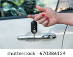 woman's hand with car key | Shutterstock . vector #670386124