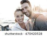 in love couple enjoying sunset... | Shutterstock . vector #670420528