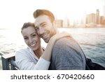 in love couple enjoying sunset... | Shutterstock . vector #670420660
