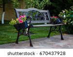 beautiful forged white bench in ...   Shutterstock . vector #670437928