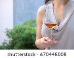 outdoor girl with wine glass ...   Shutterstock . vector #670448008