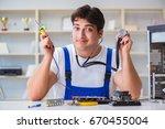 computer repairman repairing...   Shutterstock . vector #670455004