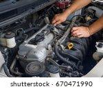 car mechanic working in auto... | Shutterstock . vector #670471990