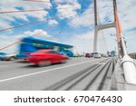 car driving on freeway under... | Shutterstock . vector #670476430