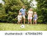 family playing soccer in summer ... | Shutterstock . vector #670486390