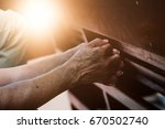 old hand  praying in the church ... | Shutterstock . vector #670502740
