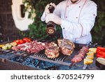 the chef prepares meat on the... | Shutterstock . vector #670524799