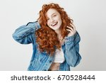 cheerful redhead girl smiling... | Shutterstock . vector #670528444