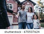 happy family is taking keys... | Shutterstock . vector #670537624