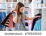 young female shopaholic holding ... | Shutterstock . vector #670542010