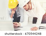 close up of two architects or... | Shutterstock . vector #670544248