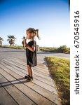 a beautiful baby girl in a... | Shutterstock . vector #670545916