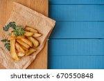 fried potatoes on a blue boards | Shutterstock . vector #670550848