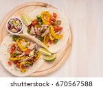 mexican tacos on pita with... | Shutterstock . vector #670567588
